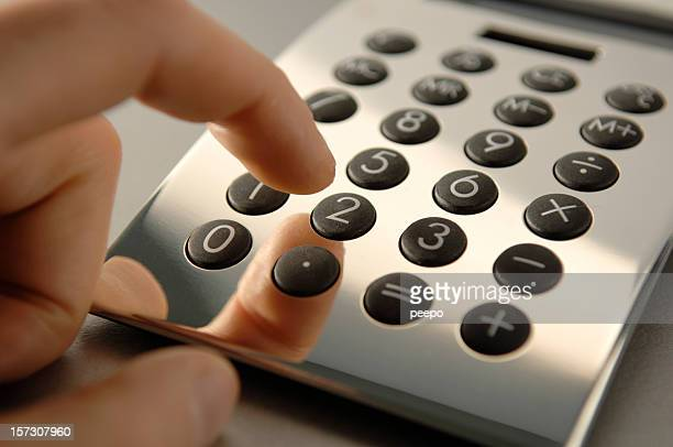 Hand Using Silver Calculator