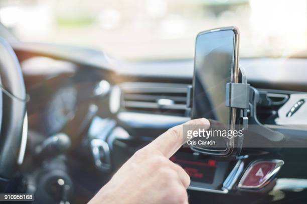 hand using smart phone while driving - navigational equipment stock pictures, royalty-free photos & images