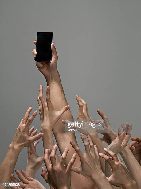 hand vying for the latest technology. - exceed and excel stock pictures, royalty-free photos & images