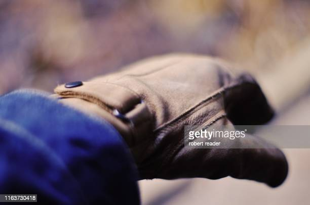 hand wearing leather working gloves - work glove stock pictures, royalty-free photos & images