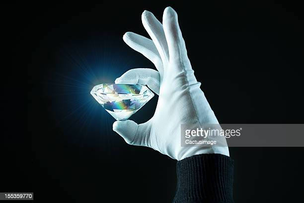 hand wit a diamond - diamond gemstone stock pictures, royalty-free photos & images