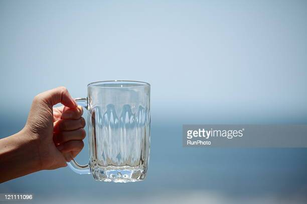 Hand with a glass jug(hand close up)