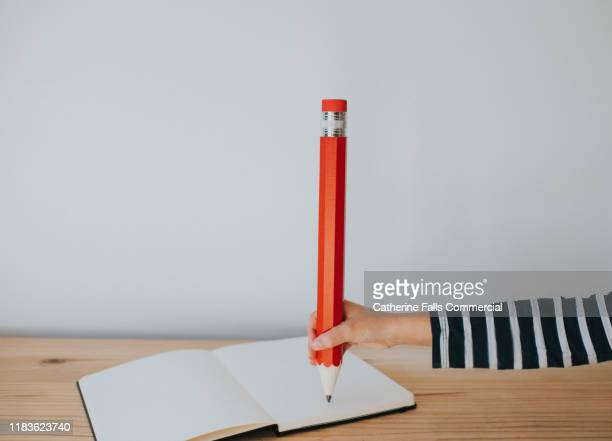 hand with a pencil - pen stock pictures, royalty-free photos & images