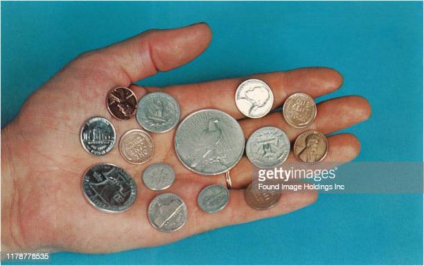Hand with a selection of American coins.