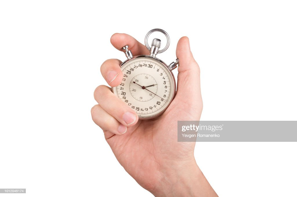 Hand with a stopwatch. Isolated on white background. : ストックフォト