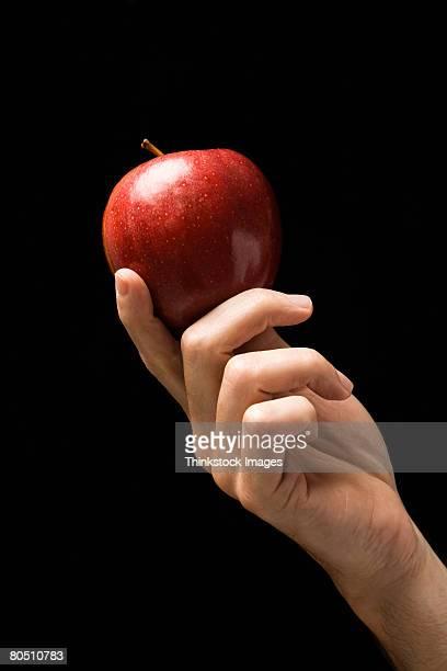 hand with apple - thinkstock stock-fotos und bilder