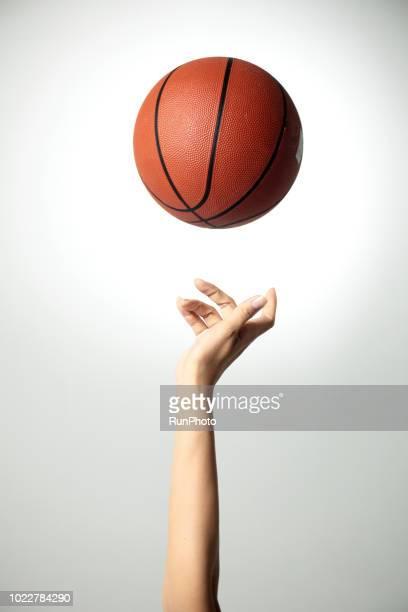 hand with basketball - バスケットボールのボール ストックフォトと画像