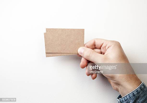 Hand with brown card business cards