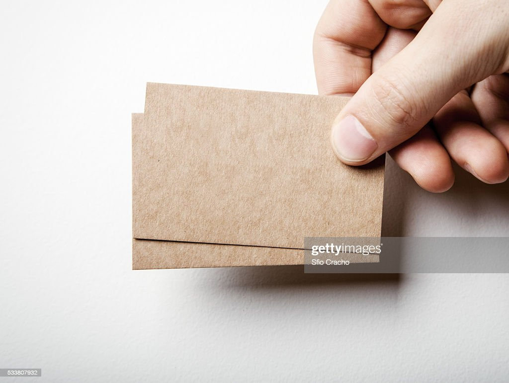Hand with brown card business cards : Foto stock