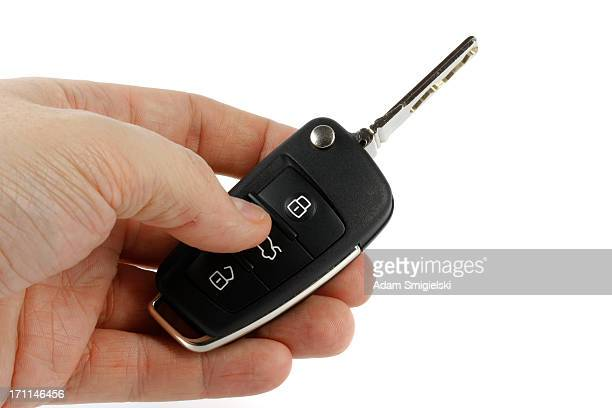 hand with car key - car alarm stock photos and pictures