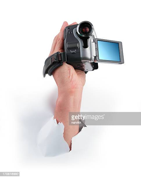 Hand with Digital Camera Taking Movie