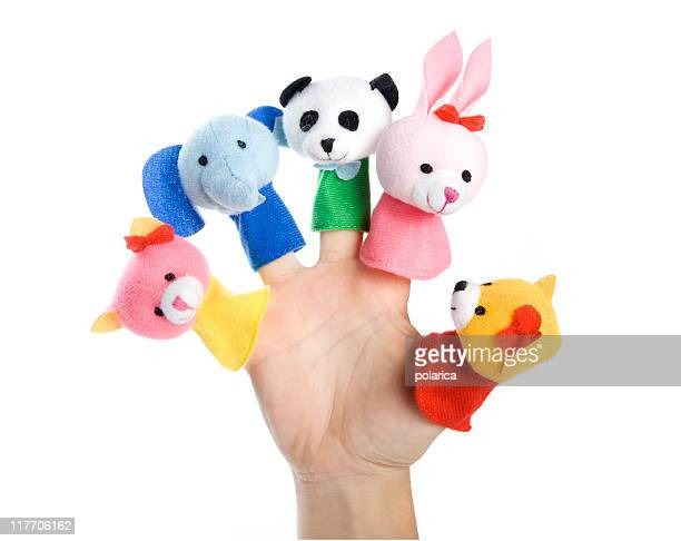 A hand with finger toys on each finger