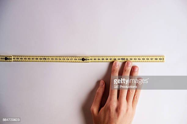 Hand with Folding Ruler