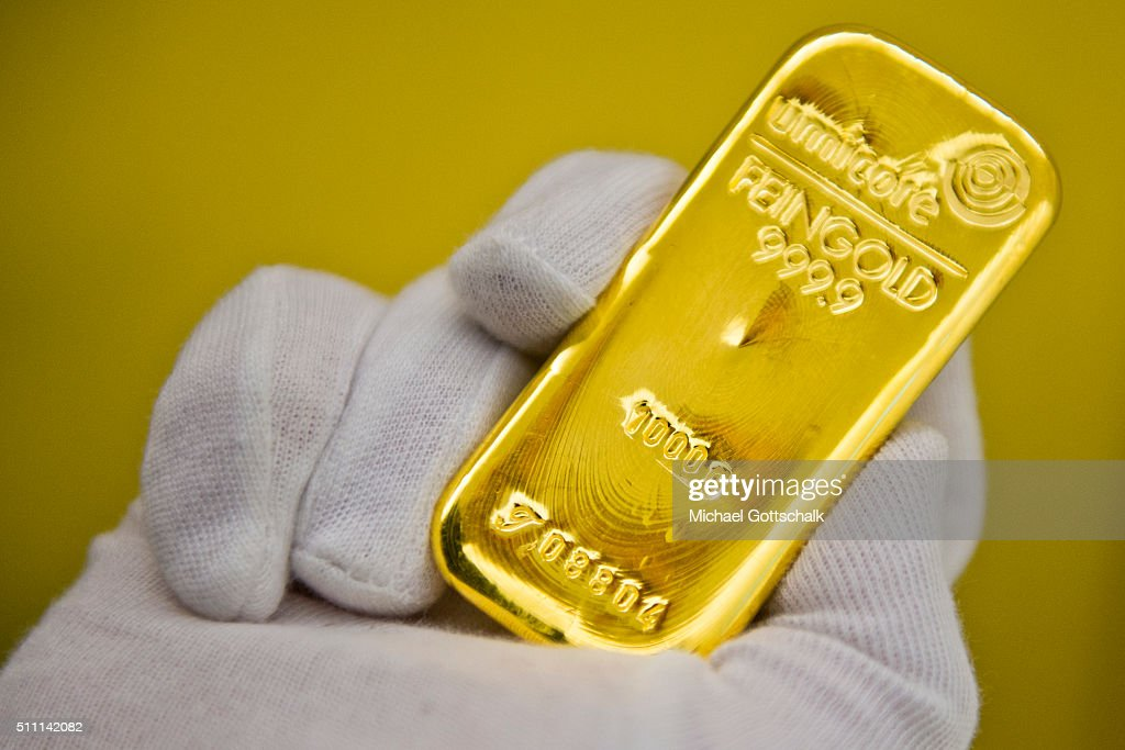 A hand with glove holds a gold bar in the safe of Pro Aurum Gold trading house on February 16, 2016 in Muenchen, Germany.
