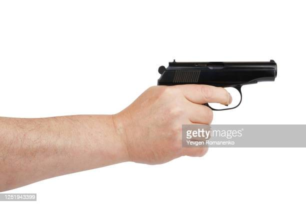 hand with gun isolated on white background - gun stock pictures, royalty-free photos & images