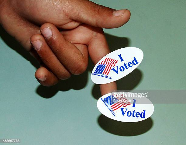 """Hand with """"I Voted"""" Stickers"""