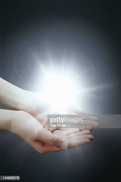 Hand with light.