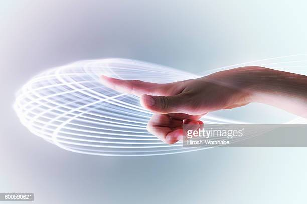 Hand with light trails