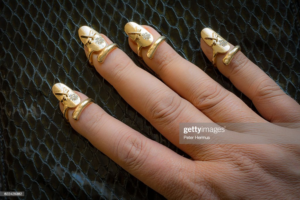 Hand With Nail Jewelry Dragonfly Metal Nail Rings Stock Photo ...