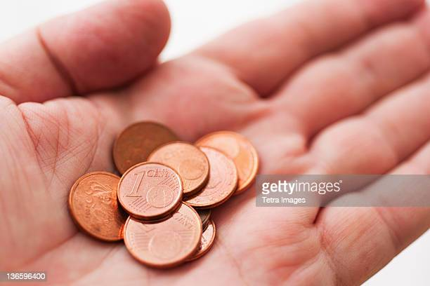 Hand with one cents coins