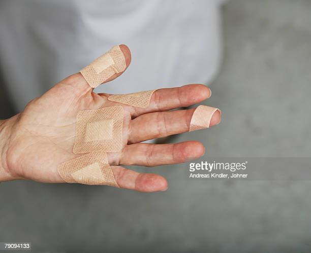 a hand with plaster. - cut on finger stock photos and pictures