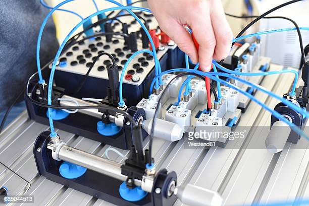 hand with pneumatics component parts - mechatronics stock pictures, royalty-free photos & images