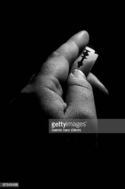 Hand with razor blade