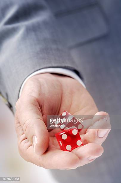 Hand with red dices