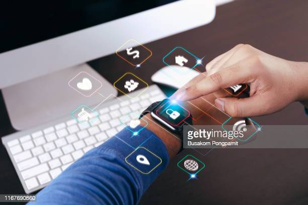 hand with smartwatch and application symbols nearby. data digital technology concept - スマートウォッチ ストックフォトと画像