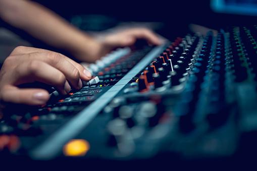 Hand with sound recording studio mixer 1064740070