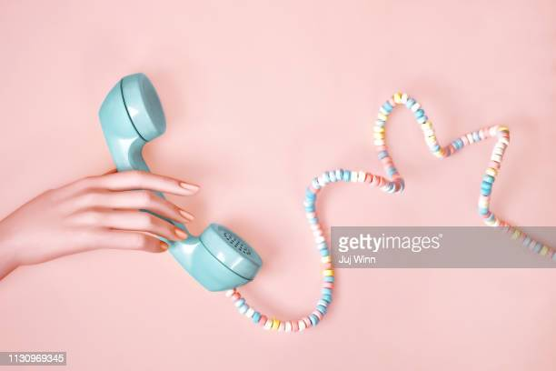 Hand with Telephone with candy cord