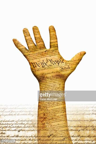 Hand with U.S. Constitution