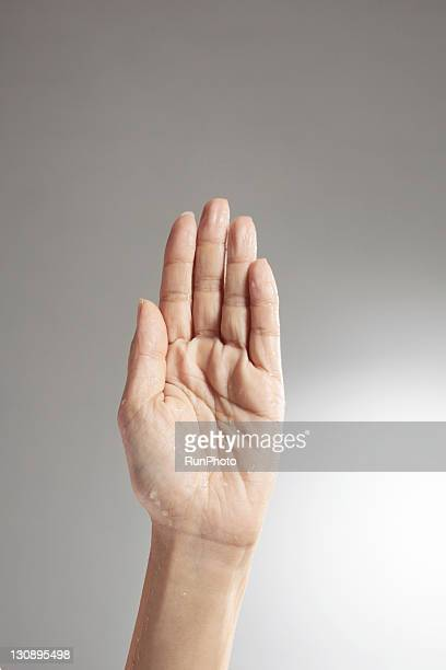 Hand with water droplets,hand close-up