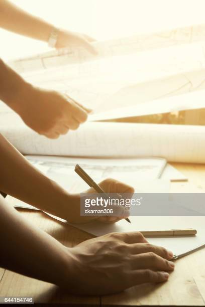 hand write blue print construction on wooden table