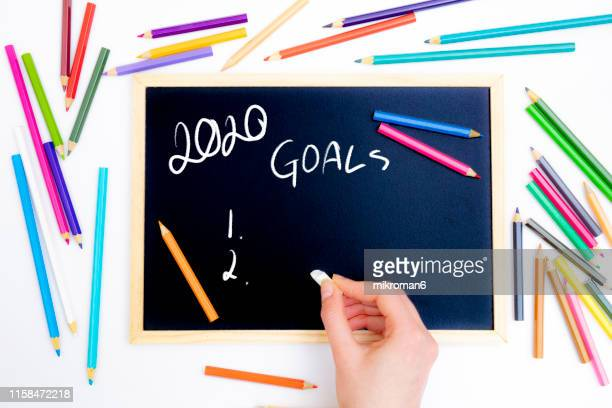 hand writing 2020 new year with chalk in black board - dessin erotique photos et images de collection