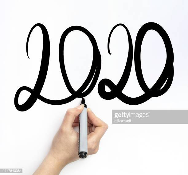 hand writing 2020 new year with chalk in white board - dessin erotique photos et images de collection