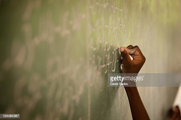 hand writing on chalkboard - haiti stock pictures, royalty-free photos & images