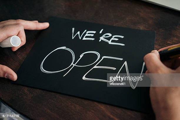 Hand writing open sign