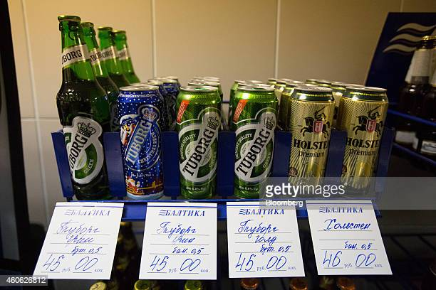 Hand written ruble price labels sit beneath Carlsberg's Tuborg and Holsten beer brands for sale in the factory store at the OAO Baltika brewery...