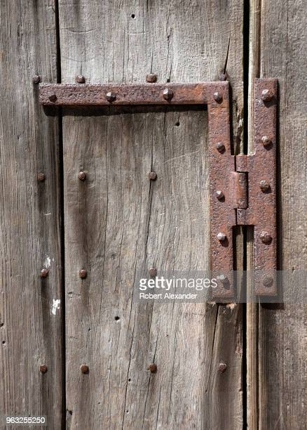A hand wrought HL hinge on the door of a tomb which originally held the remains of George Washington at Mount Vernon the plantation owned by...