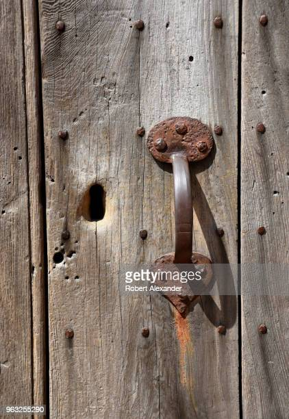 A hand wrought iron handle on the door of a tomb which originally held the remains of George Washington at Mount Vernon the plantation owned by...