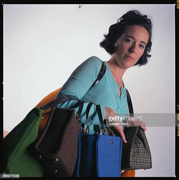 Handbag designer Kate Spade is photographed for German Elle in September 1996 in New York City. She holds a collection of purses.
