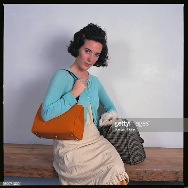 Handbag designer Kate Spade is photographed with her pet Maltese for German Elle in September 1996 in New York City She holds two of her purses