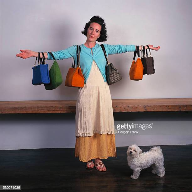 Handbag designer Kate Spade is photographed with her pet Maltese for German Elle in September 1996 in New York City She holds a collection of purses...