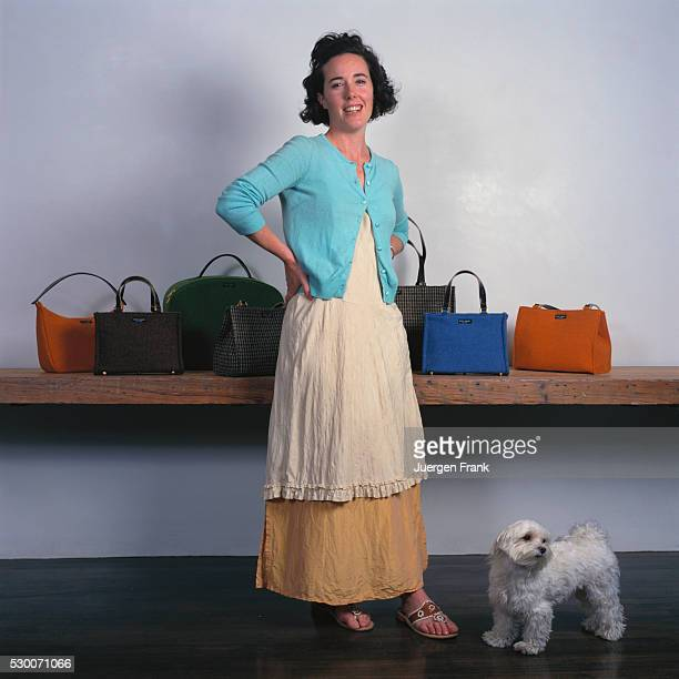 Handbag designer Kate Spade is photographed with her pet Maltese for German Elle in September 1996 in New York City. A collection of purses sit on a...