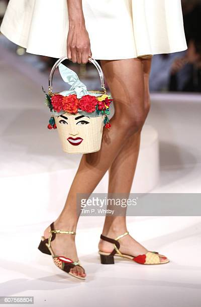 Handbag detail as a model walks the runway at the Charlotte Olympia show during London Fashion Week Spring/Summer collections 2017 at Park Lane Hotel...
