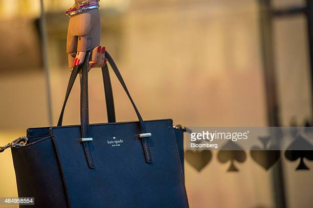 A handbag hangs on display in the window of a Kate Spade Co store in Corte Madera California US on Friday Feb 27 2015 Kate Spade Co is expected to...