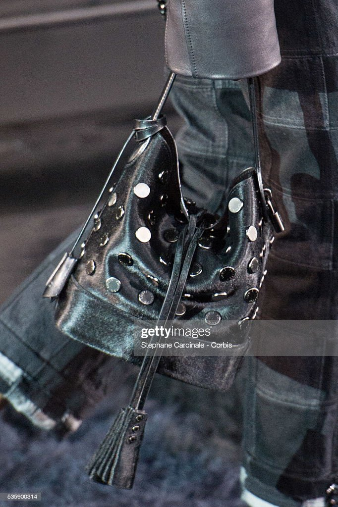 Handbag is carried by a model as she walks the runway during Louis Vuitton show at 'Cour Carre du Louvre', as part of the Paris Fashion Week Womenswear Spring/Summer 2014, in Paris.