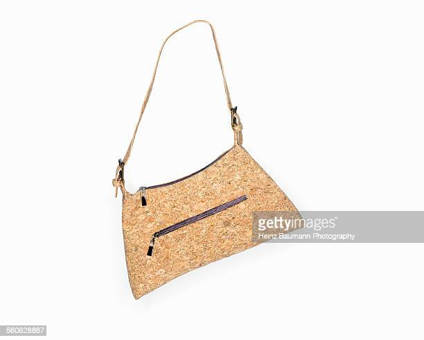 Handbag made of cork on white background