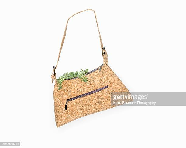 Handbag made of cork with stonecrop sedum on white
